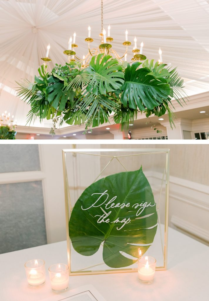 Chandelier covered in palm leaves and ferns for a Savannah wedding