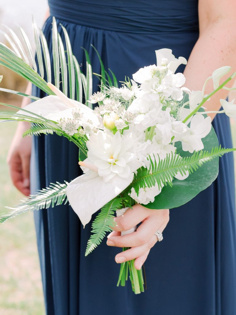 Bridesmaids bouquets with palm leaves, ferns, dahlias and ranunculus